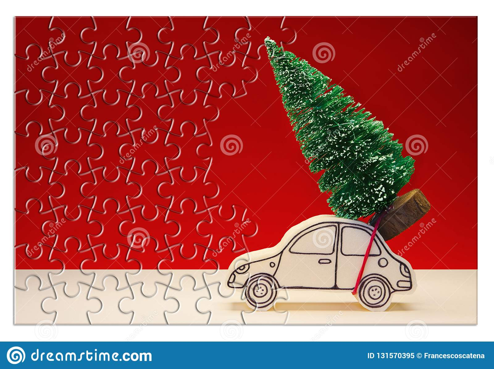 Hurry up! Christmas is coming! Holiday concept with a small pine tree on handmade cartoon toy car in jigsaw puzzle shape