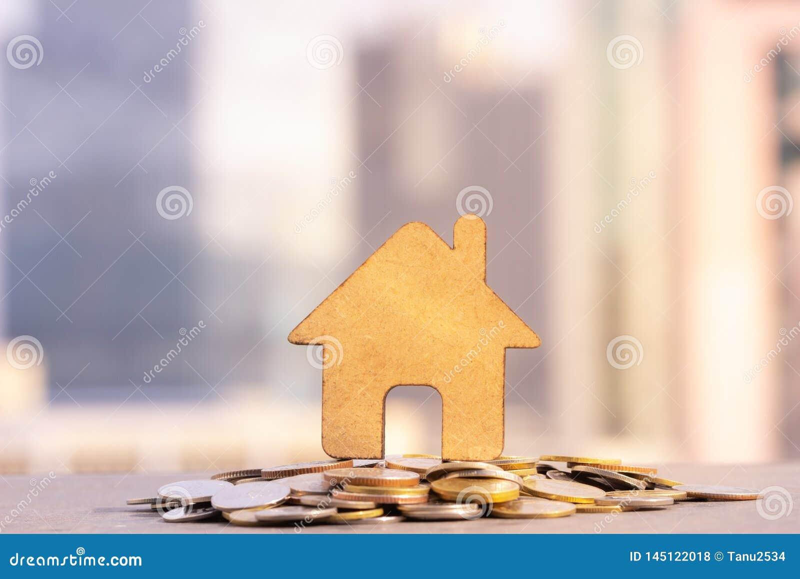 Hus- och myntbunt f?r att sparande ska k?pa ett hus Det egenskapsinvesteringen och huset intecknar finansiellt begrepp