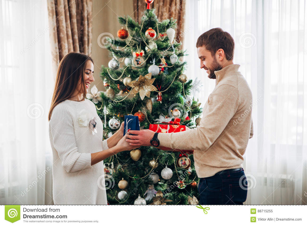The Husband Gives Christmas Gift To His Wife Stock Image - Image of ...