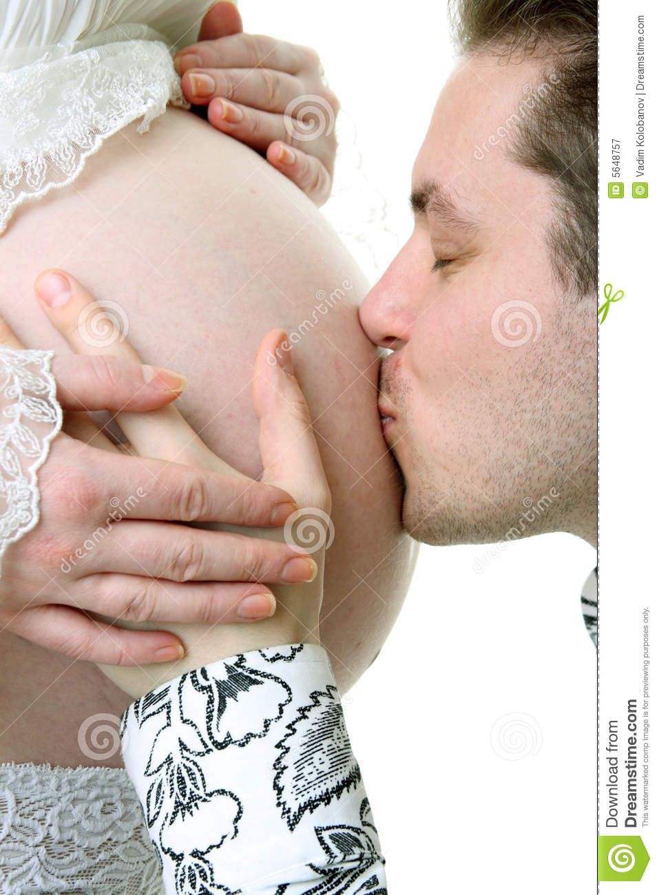 Happy husband kissing belly of pregnant woman — Stock ...