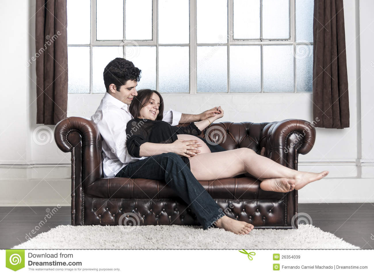 husband and pregnant wife at home royalty free stock
