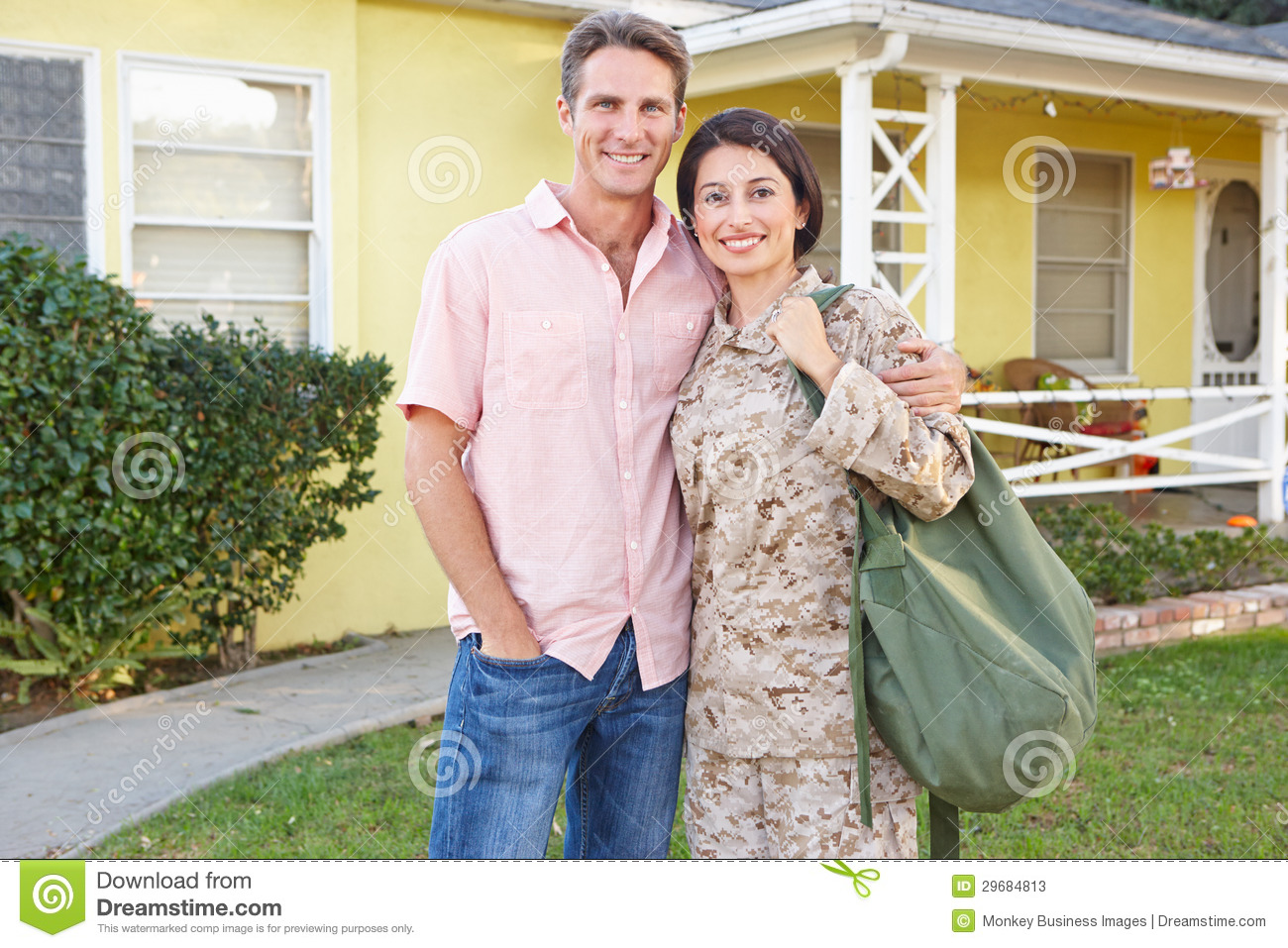 Husband Welcoming Wife Home On Army Leave Stock Image