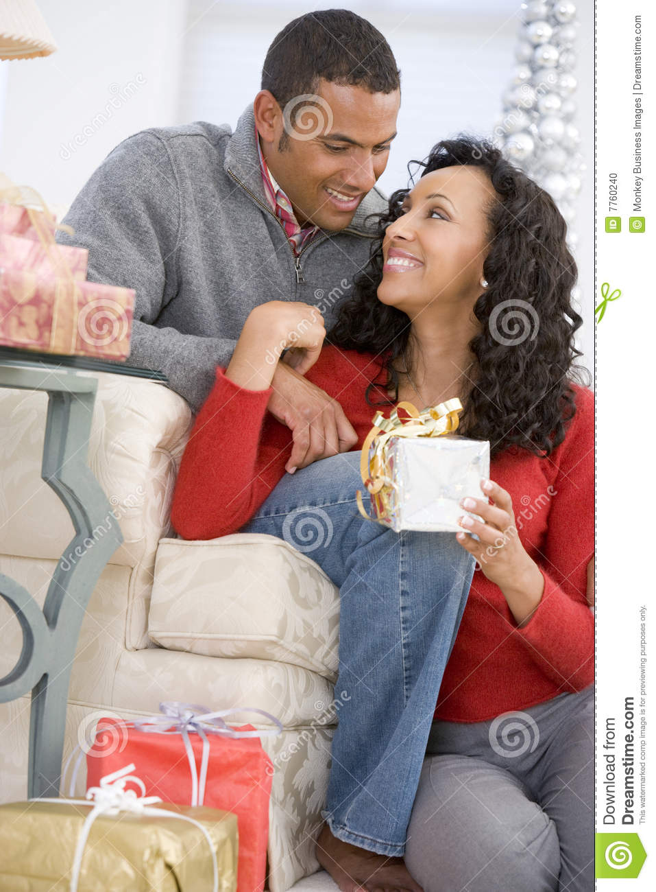 Husband and wife exchanging christmas gifts stock photo Christmas presents for wife