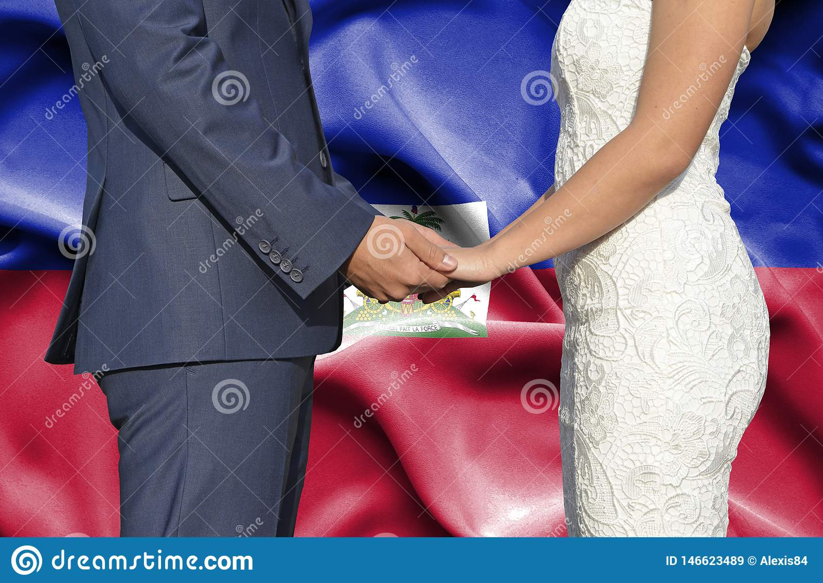Husband and Wife holding hands - Conceptual photograph of marriage in Haiti