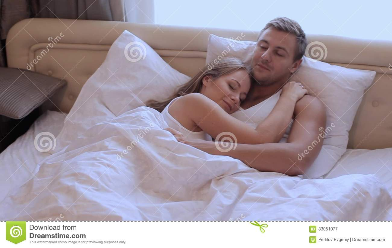 . Husband And Wife Lying In Bed In An Embrace Stock Video   Video of