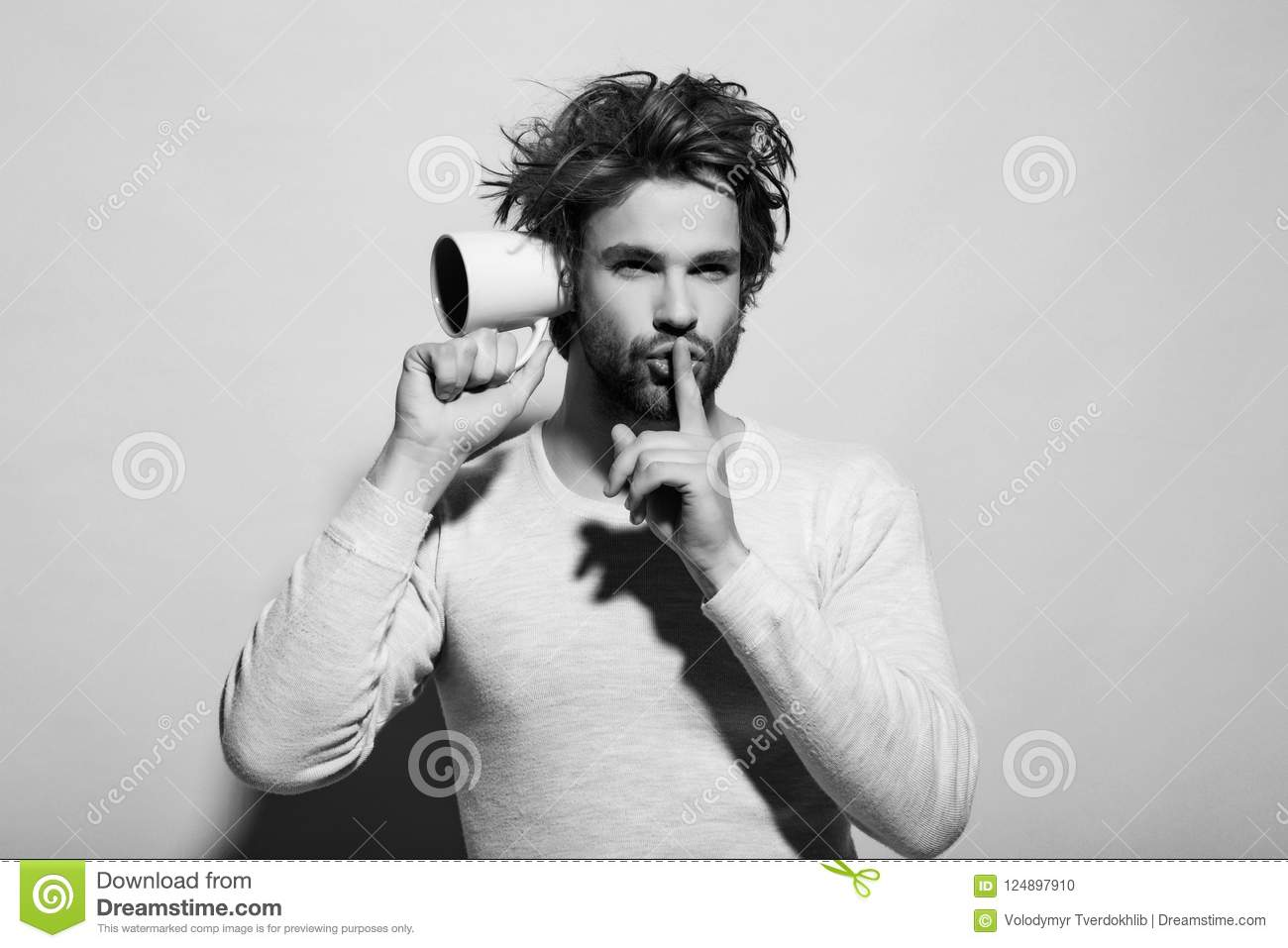 Hush gesture of man overhear with cup