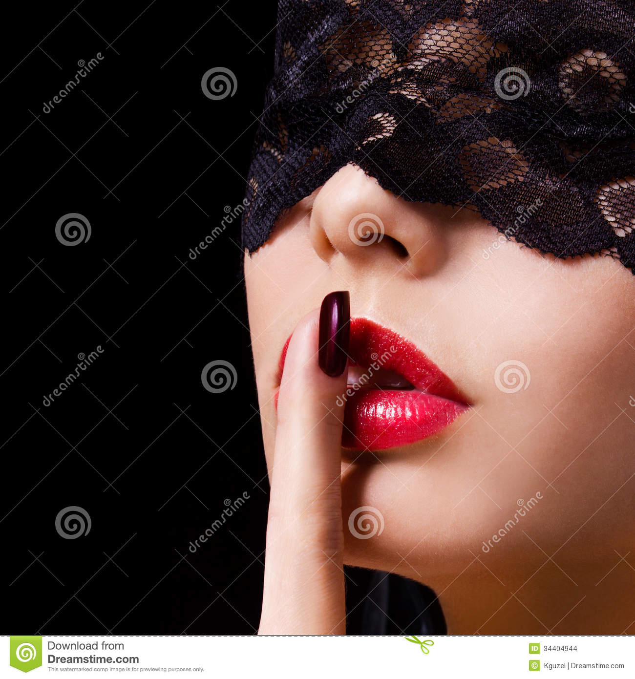 Hush. woman with finger on her red lips showing shush. Erotic girl with lace mask over black
