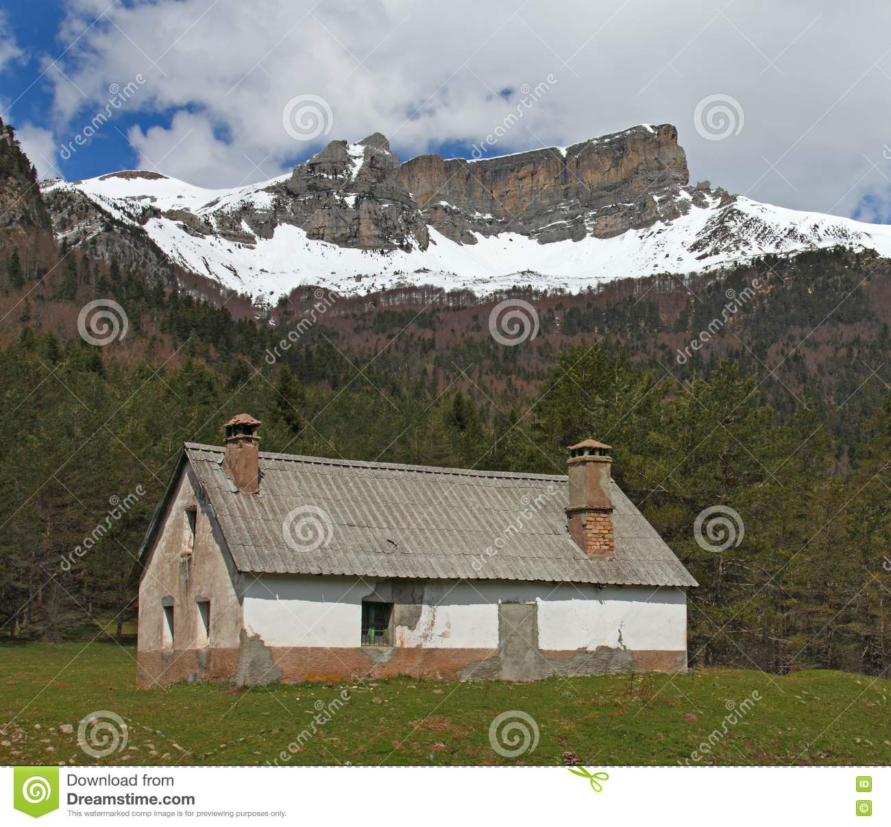 Snowy Peaks Christmas Tree Farm: Hut And Snow-covered Mountains In Pyrenees Stock Photo