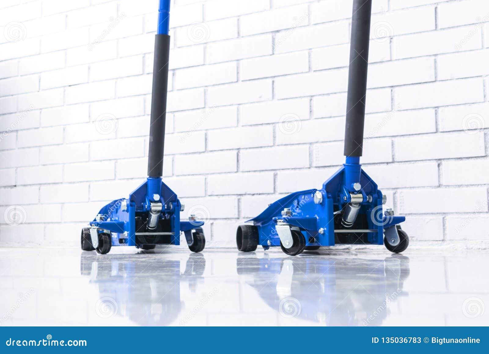 Hydraulic car floor jacks. Car Lift. Blue Hydraulic Floor Jack For car Repairing. Extra safety measures. Car service station.