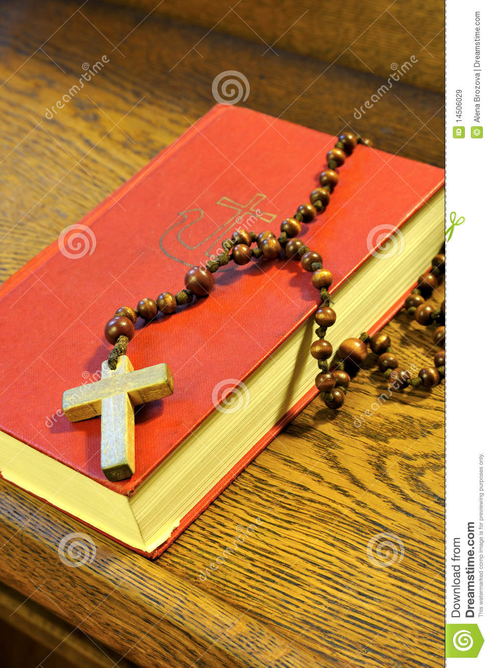 Hymnal book and wooden rosary bead