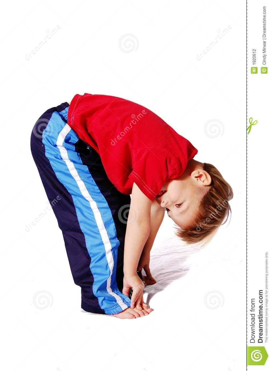cute four year old boy wearing red and blue who is bending over and ...