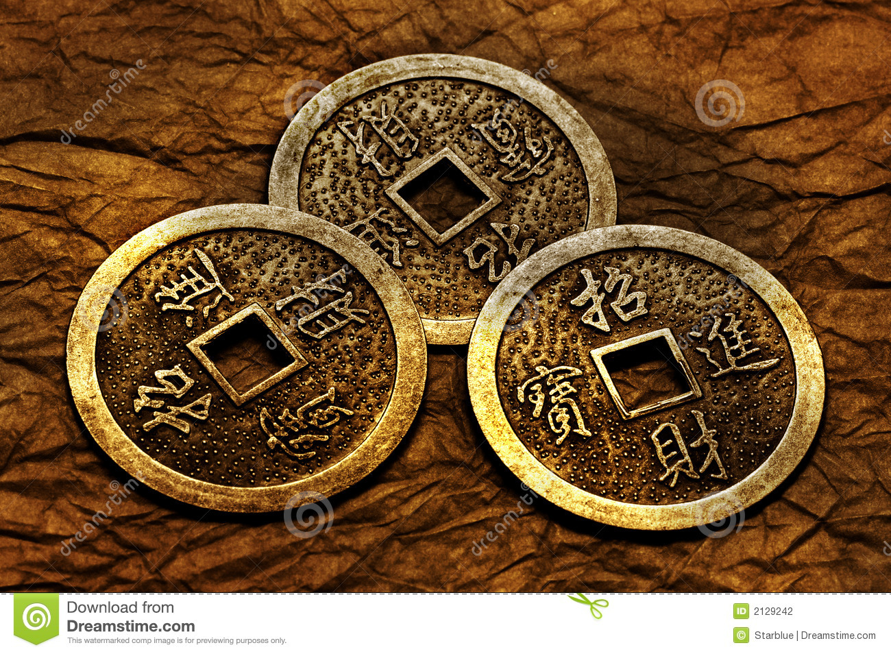 Three gold coins used for i-ching prophecy in gold lightning.