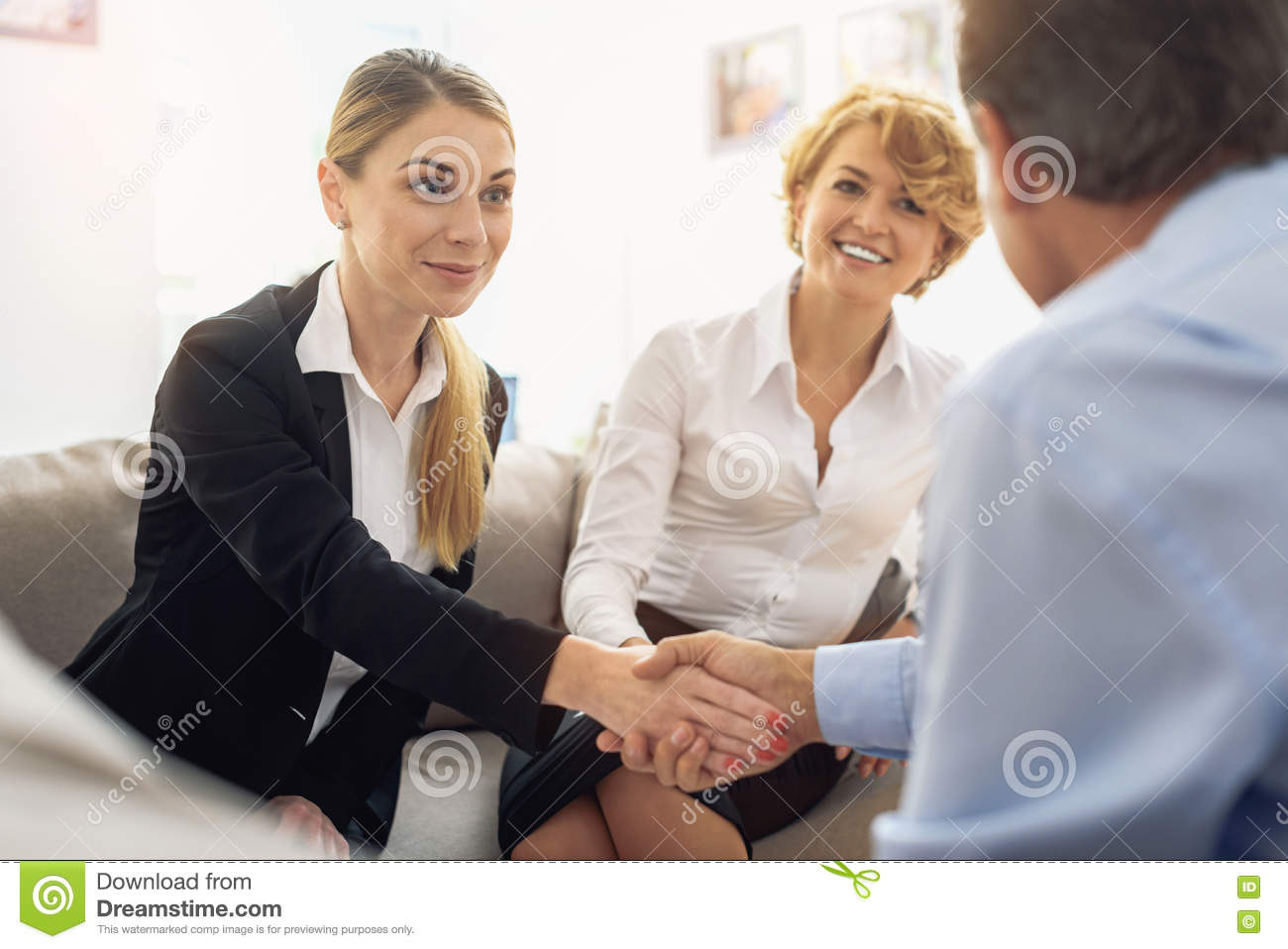 Business people handshake greeting deal at work photo free download - I Am Glad To Work With You Happy Young Businesswoman Is Greeting Her Business Partner By Handshake