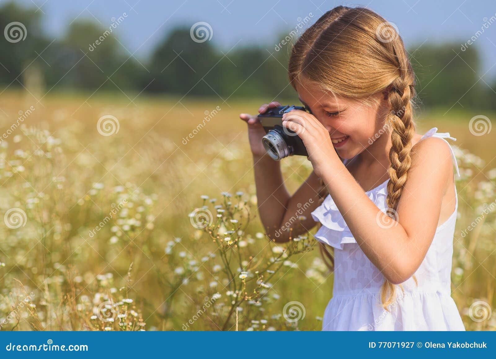 Cheerful girl photographing beautiful nature stock photo for Cheerful nature