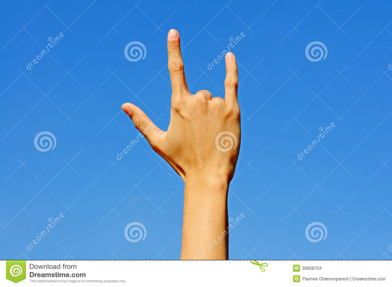 I Love You In Hand Sign Language On Blue Sky Background Stock Photo