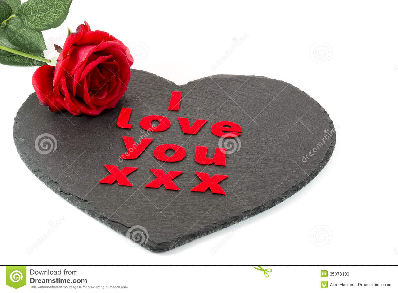 i love you with a red rose on a heart shaped slate with a white