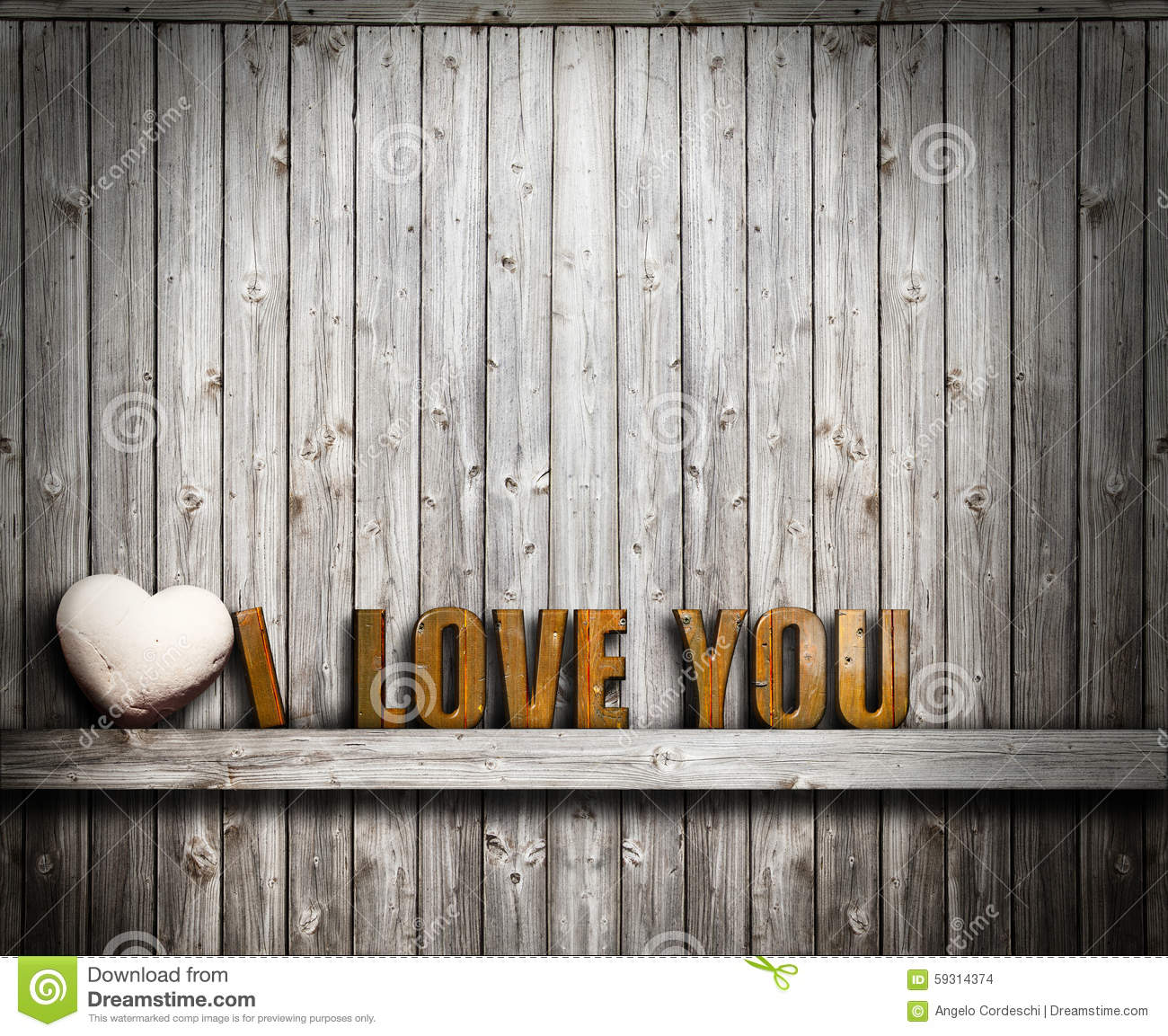 I love you Valentines day. Text and heart stone on wooden background