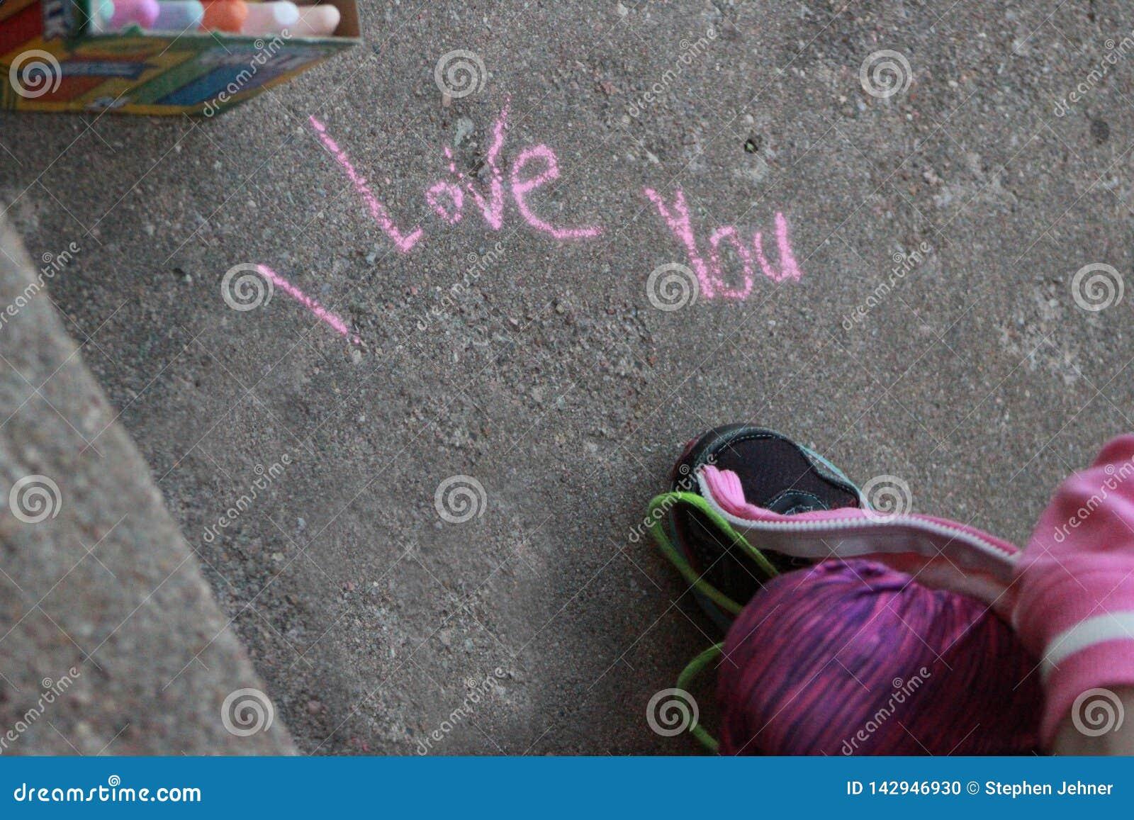 I love you written in sidewalk chalk
