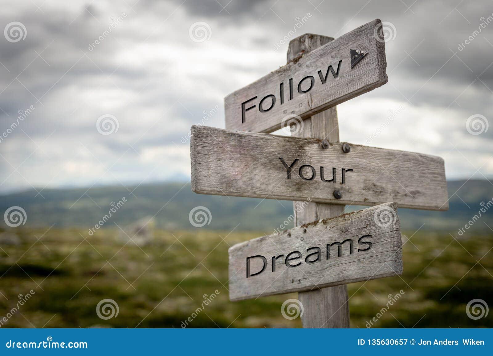 Follow your dreams signpost.