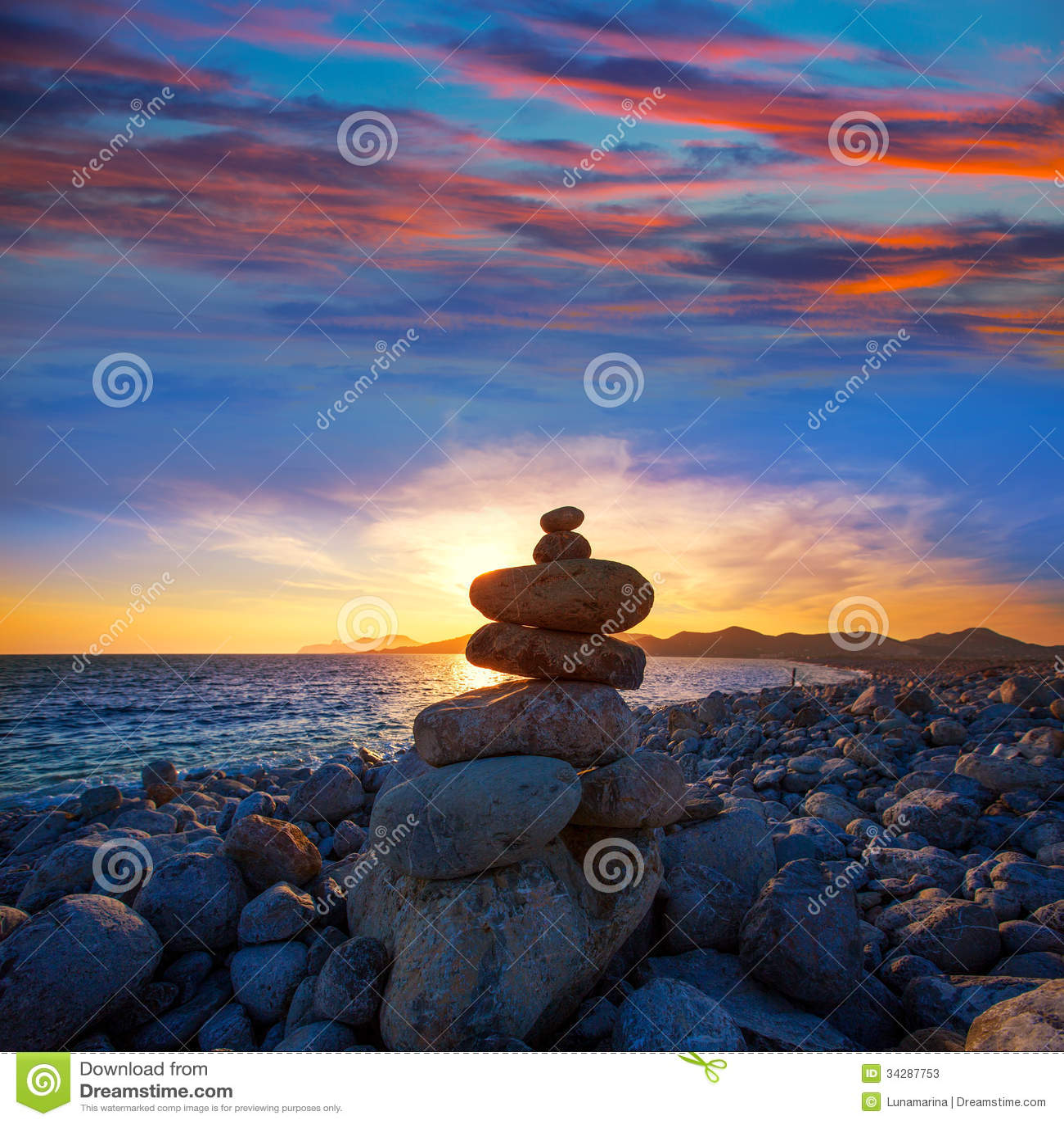 Ibiza Cap des Falco beach sunset with desire stones