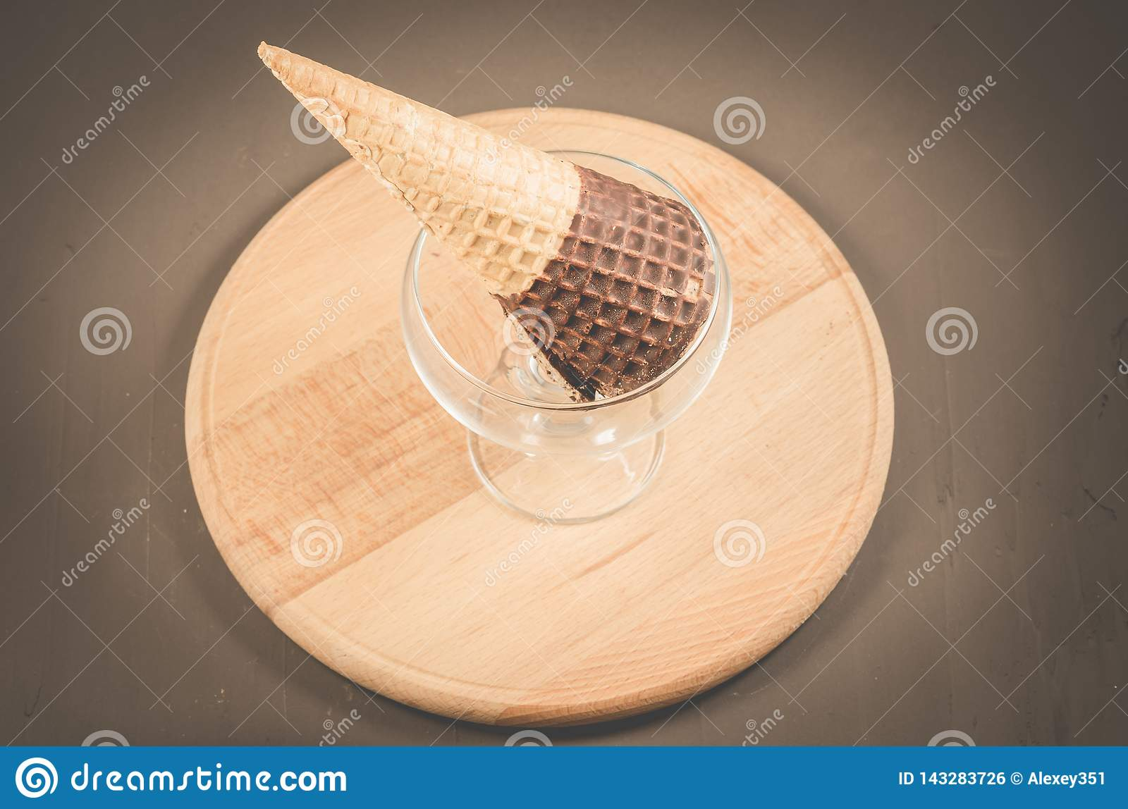 ice cream with cone in chocolate in a glass ice cream parlor/ice cream with cone in chocolate in a glass ice cream parlor on a