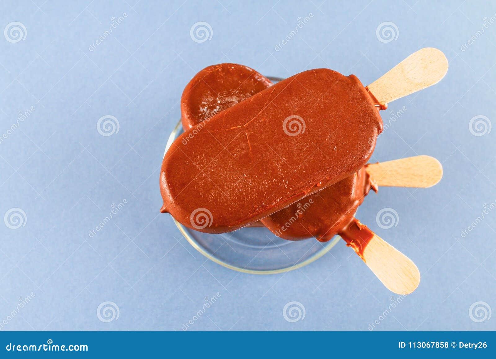 Ice cream on a glass saucer on a gray table. Eskimo.