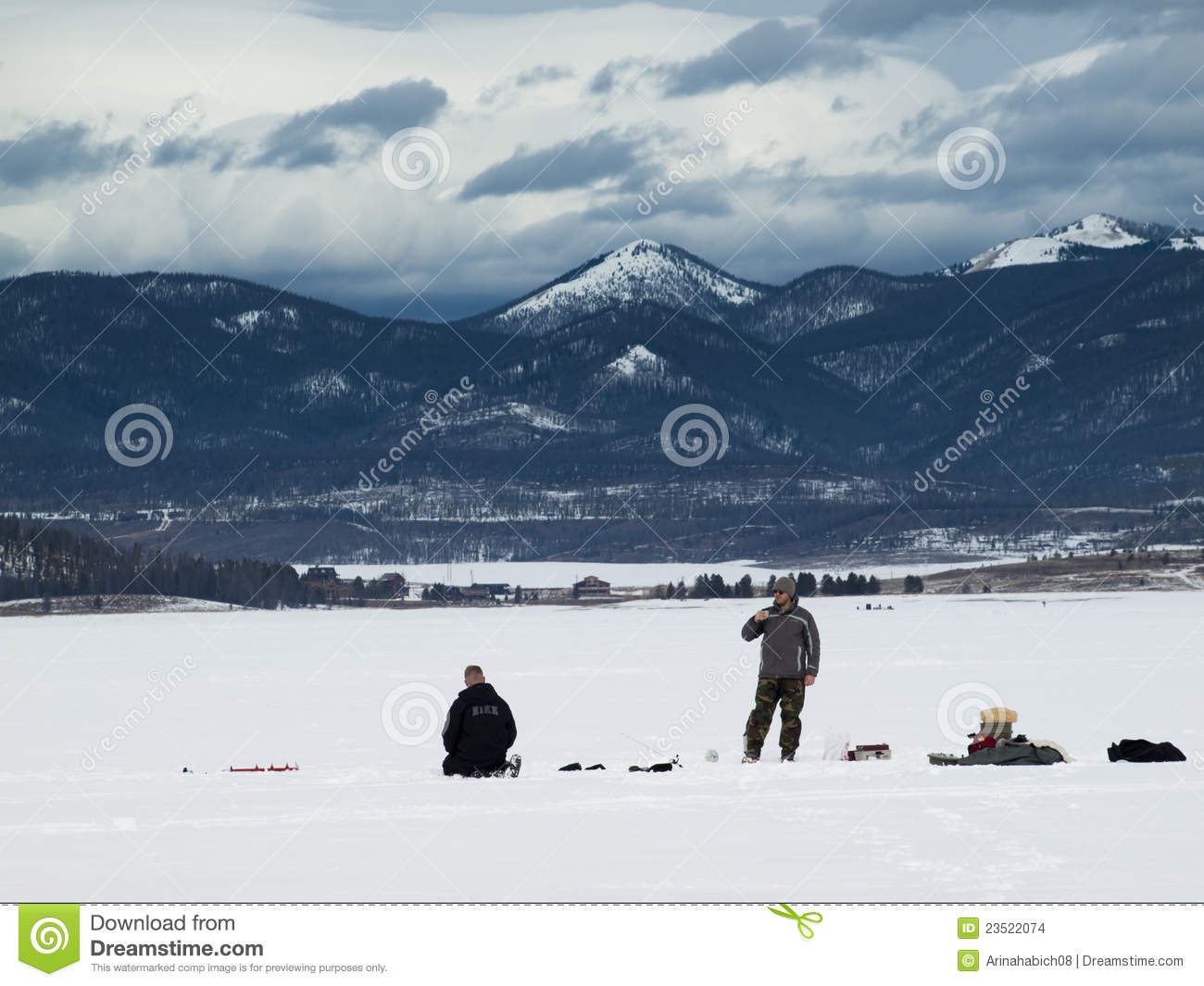 Ice fishing editorial stock image image 23522074 for Lake granby fishing report