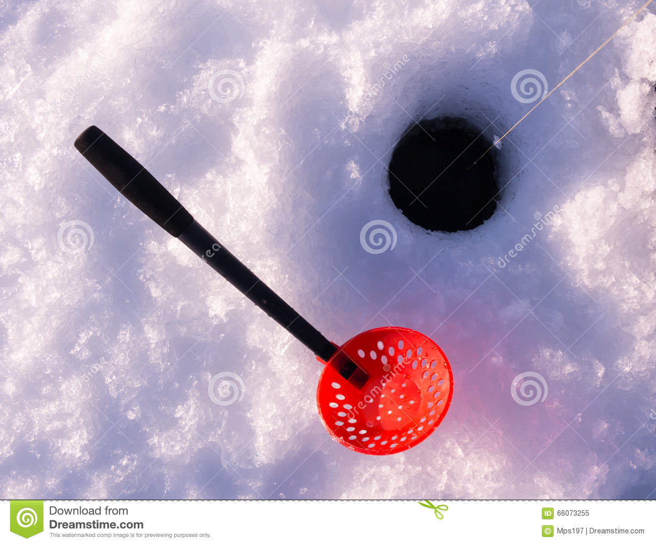 Ice fishing hole with a scoop for removing slush stock for Ice fishing scoop