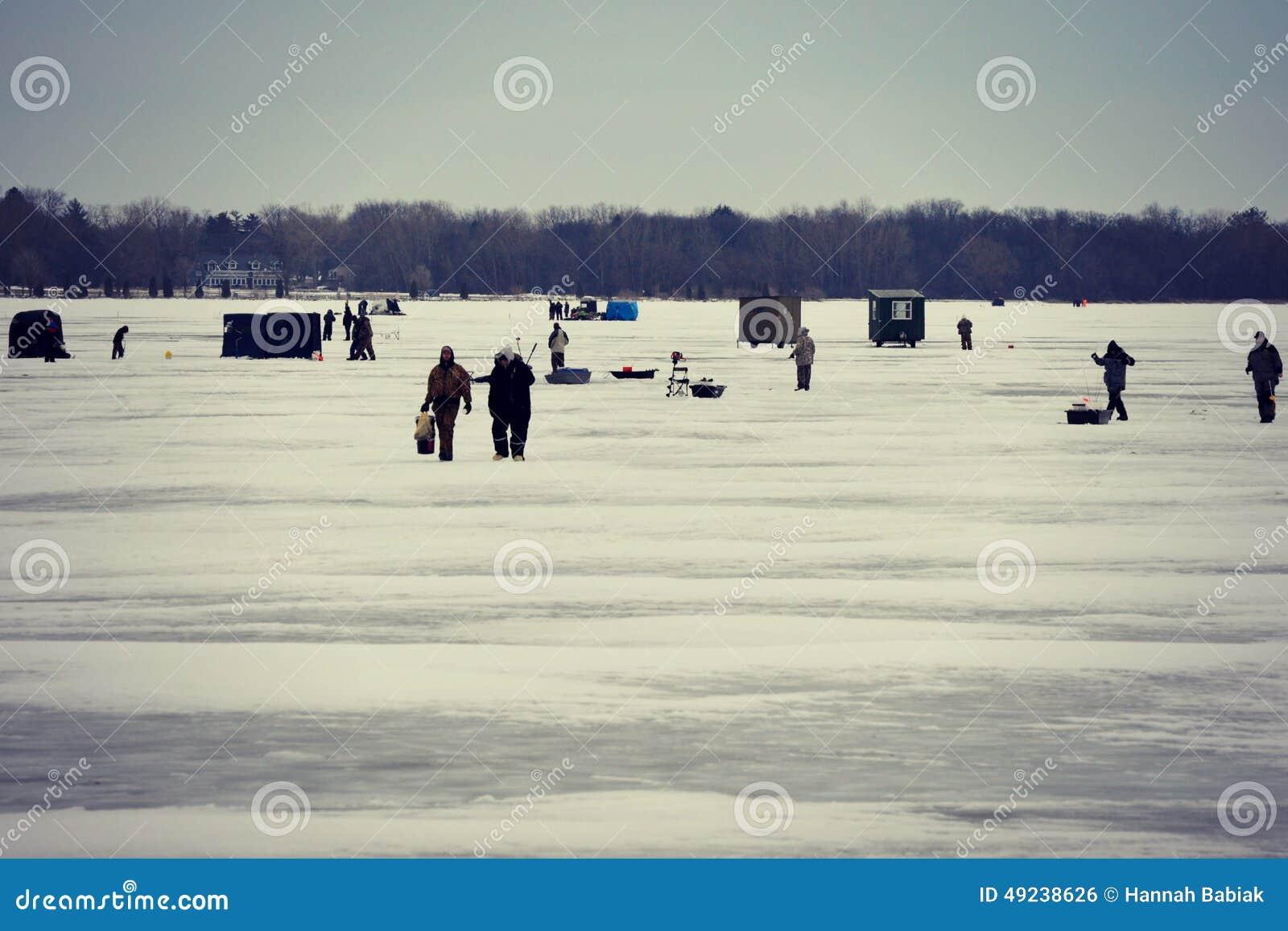 Ice fishing editorial photo image 49238626 for Lake delavan fishing