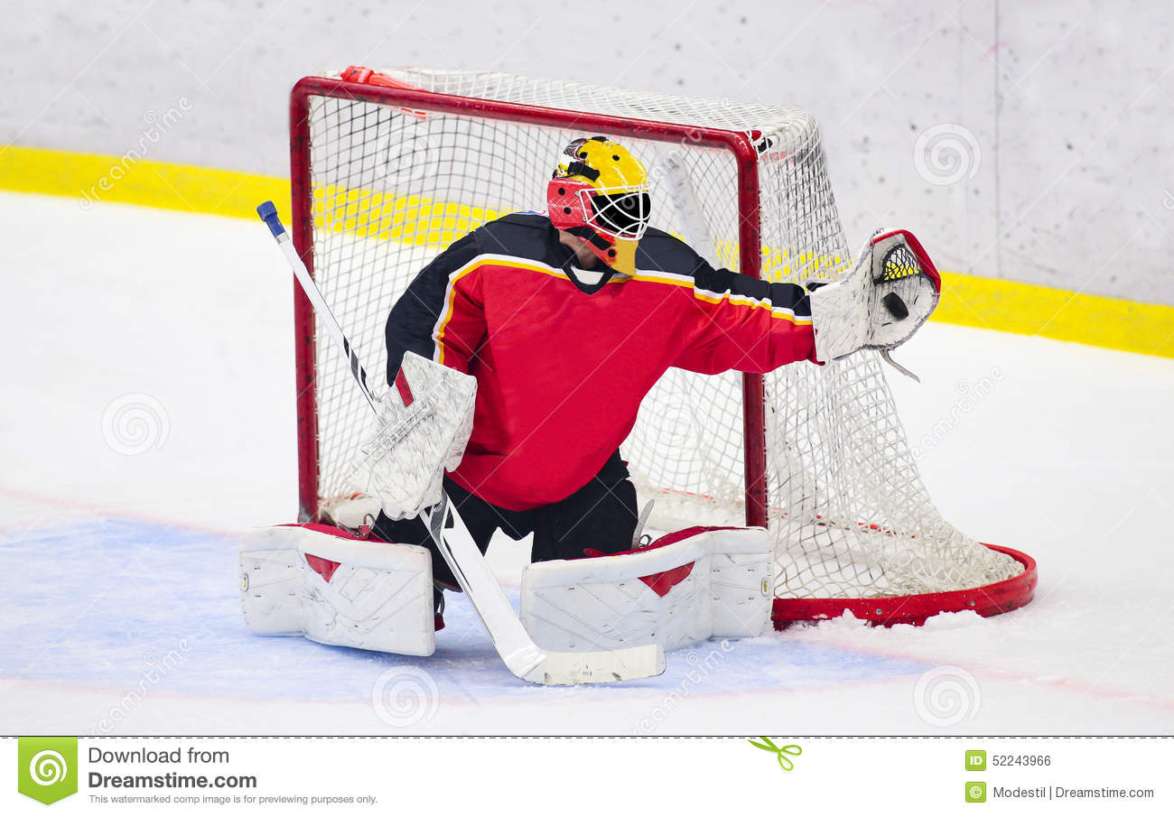 Ice Hockey - Goalie catches the puck