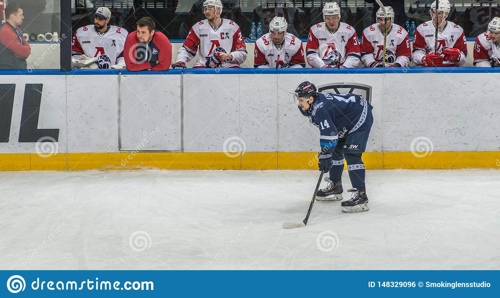 Ice hockey player in front of bench