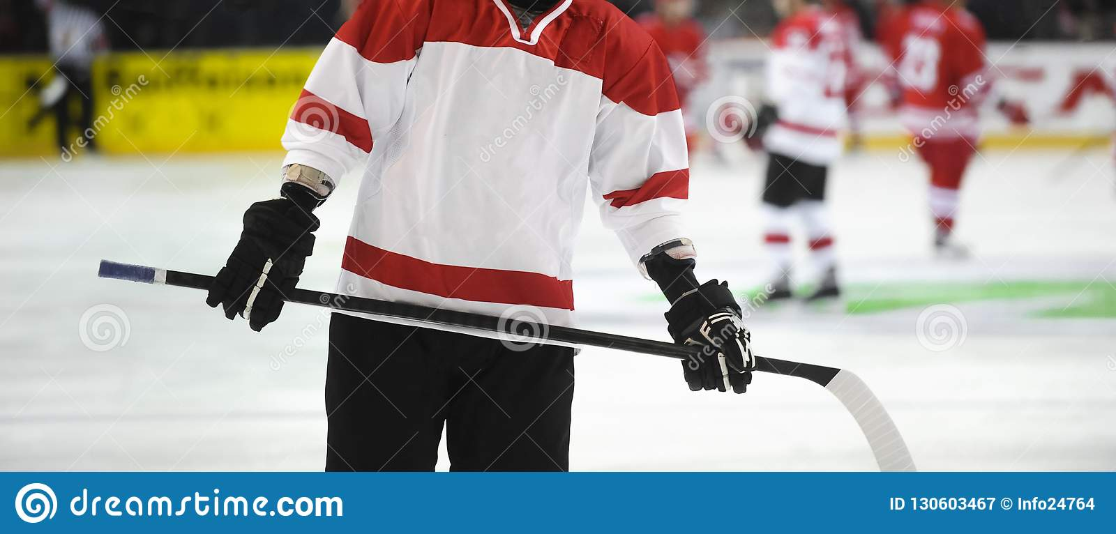 Ice hockey player on the ice. Team sport
