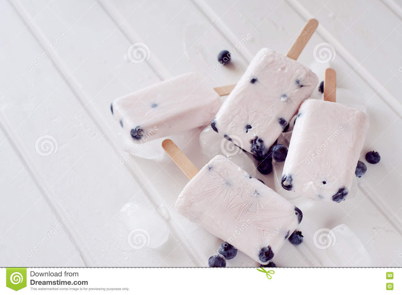 Ice Popsicles With Yogurt And Blueberries In Ice Lolly Mold Stock
