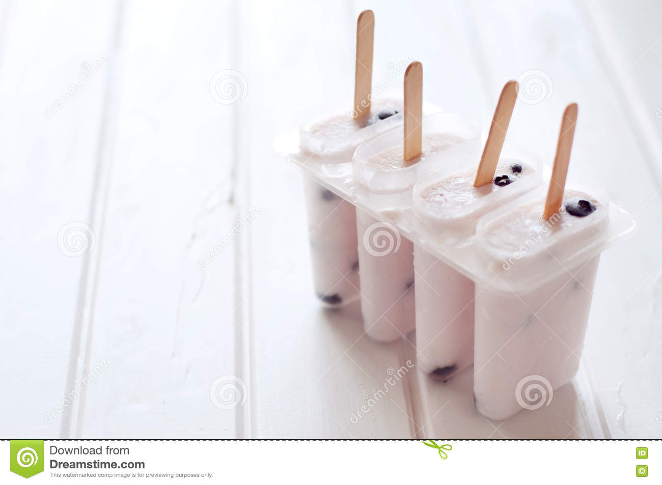 Ice Popsicles With Yougurt And Blueberries In Ice Lolly Mold Stock