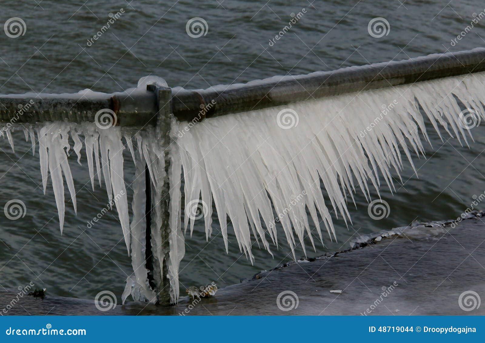 Ice on railing stock photo image