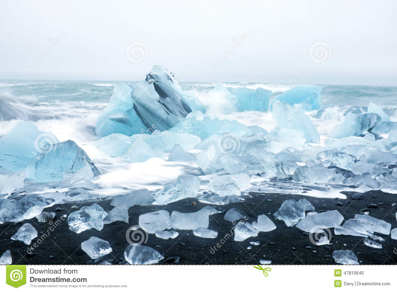 ice rocks on a black sand beach in iceland stock photo. Black Bedroom Furniture Sets. Home Design Ideas