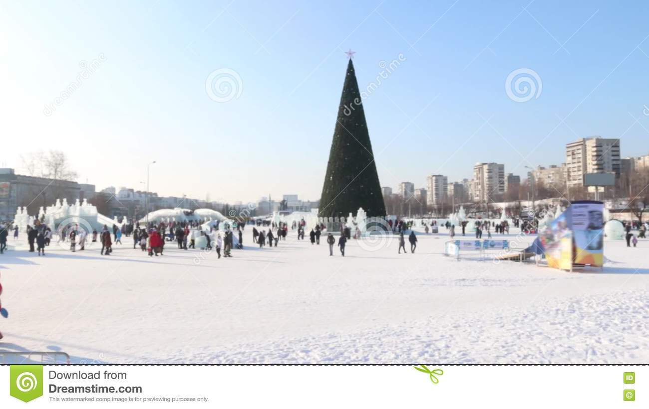 Ice Sculptures, Walking People And Christmas Tree In Perm, Russia At ...