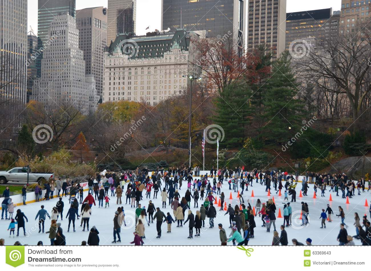 ice skating people with white christmas in central park new york city usa