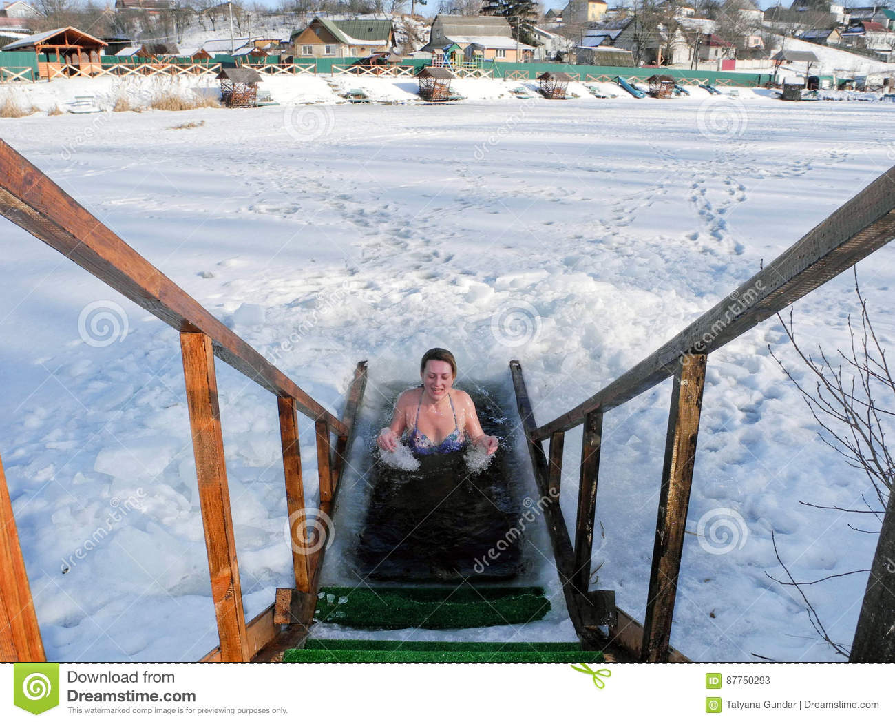 Ice swimming in the winter ice-hole after a sauna.