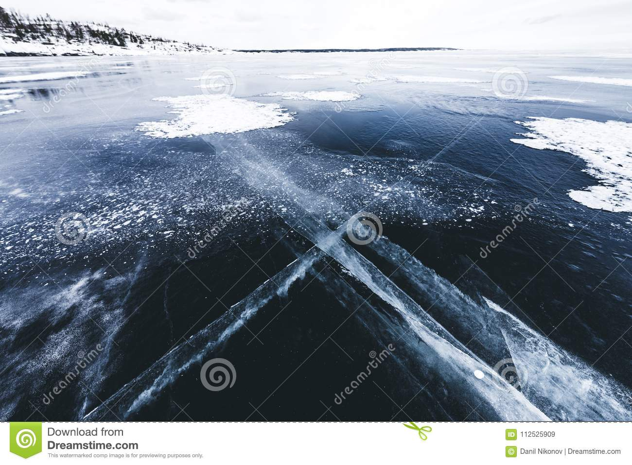 Crack In The Ice On A Frozen Lake Covered With Snow Cracked