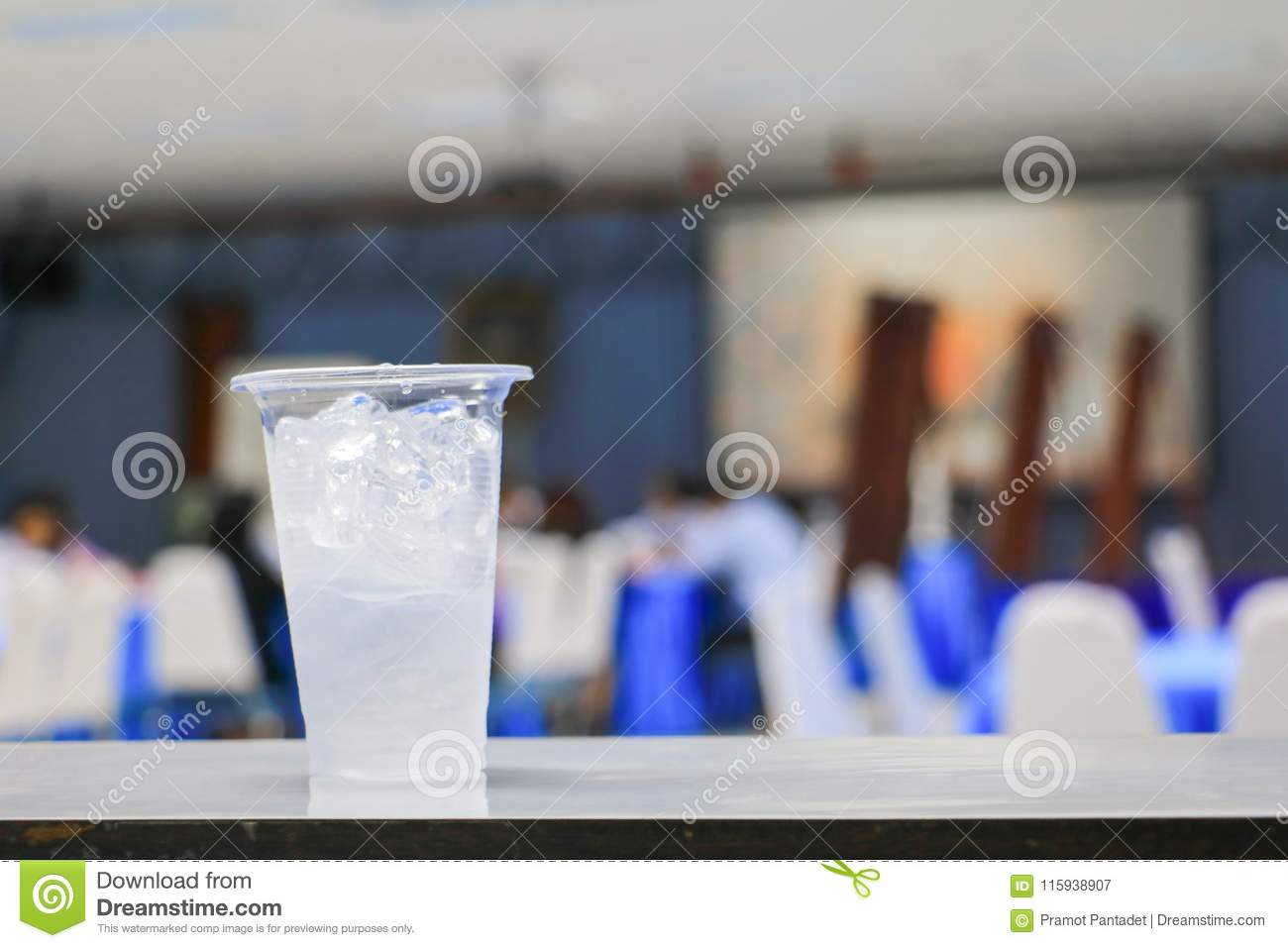 Ice water in glass-plastic in seminar conference room background. select focus with shallow depth of field