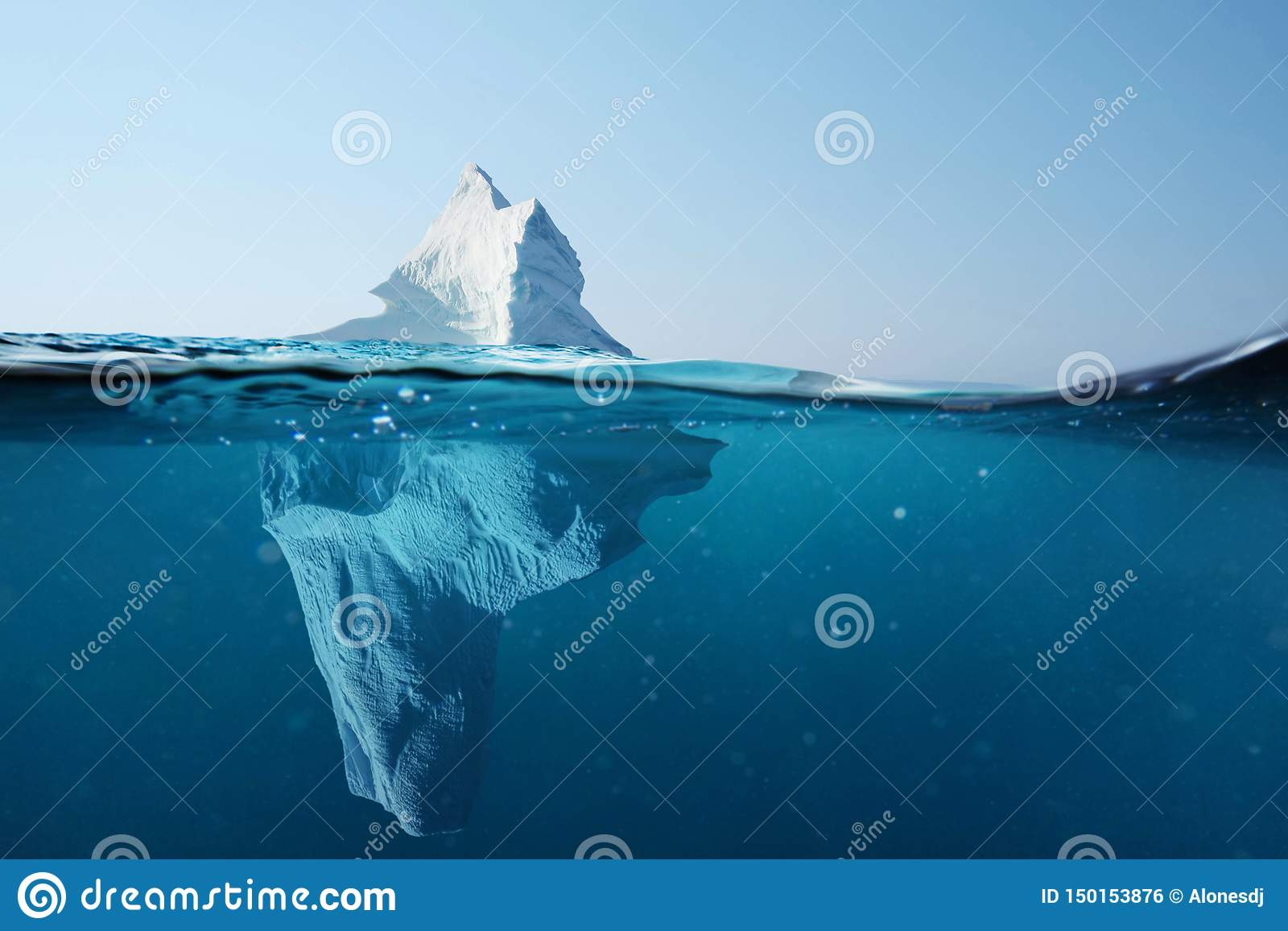Iceberg in the ocean with a view under water. Crystal clear water. Hidden Danger And Global Warming Concept.