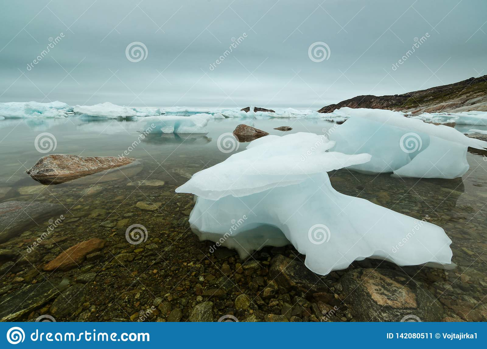 Iceberg stuck in the shallow waters, Ilulissat Icefjord, Greenland