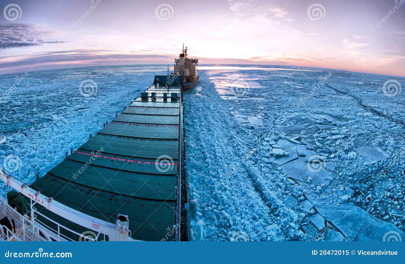 Icebreaker towing cargo ship