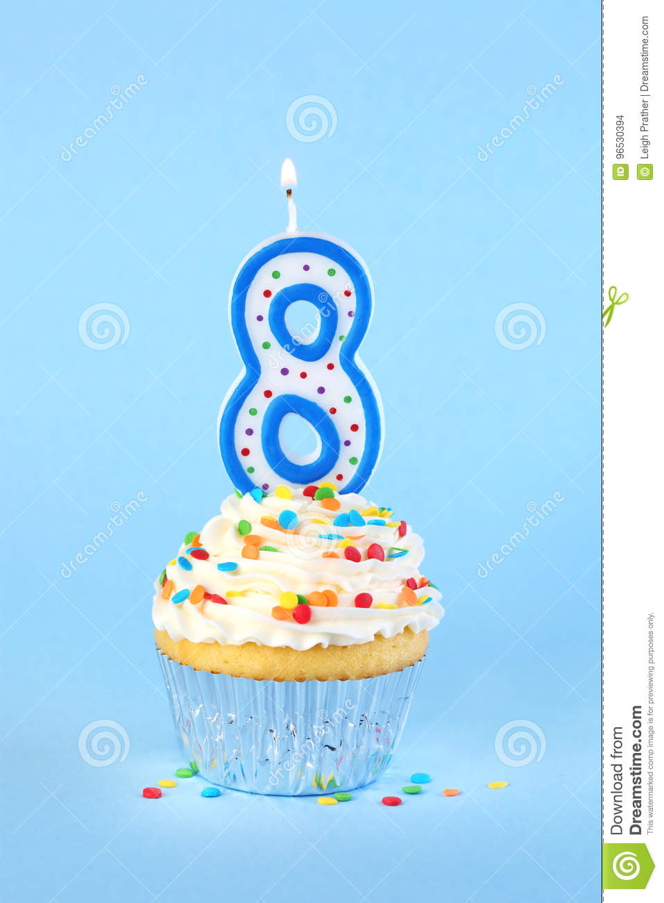 Iced Birthday Cupcake With Lit Number 8 Candle