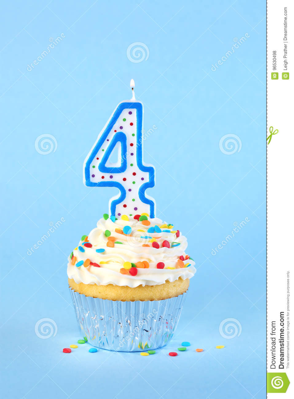 Iced Birthday Cupcake With Lit Number 4 Candle
