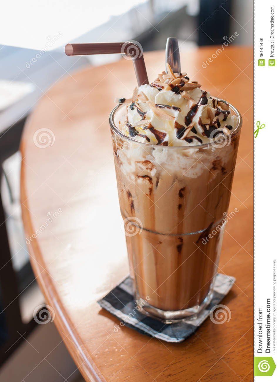Iced coffee with whipped cream and sprinkle with almonds.