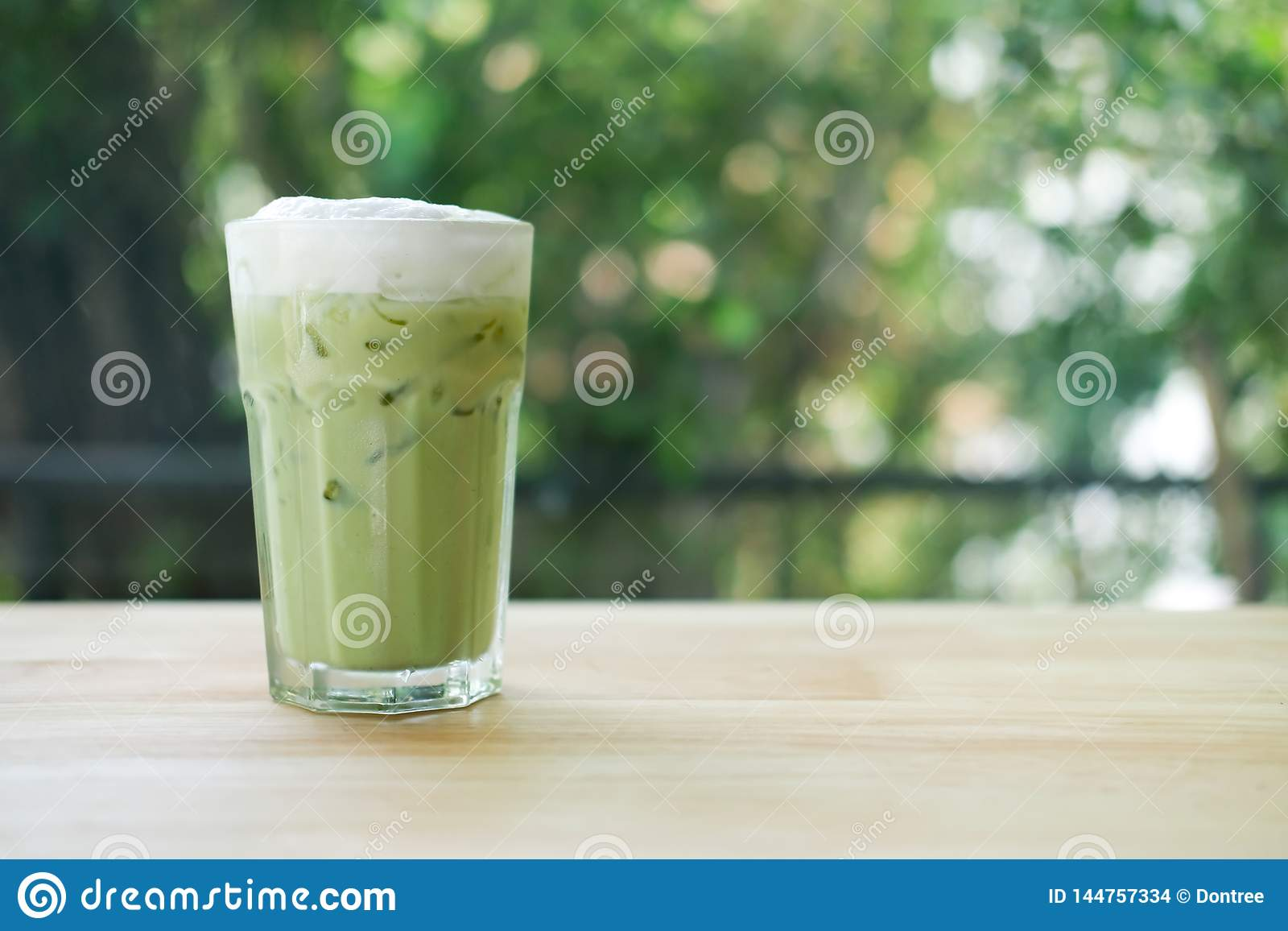 Iced Green Tea With Milk Froth On Top In Glass Stock Photo