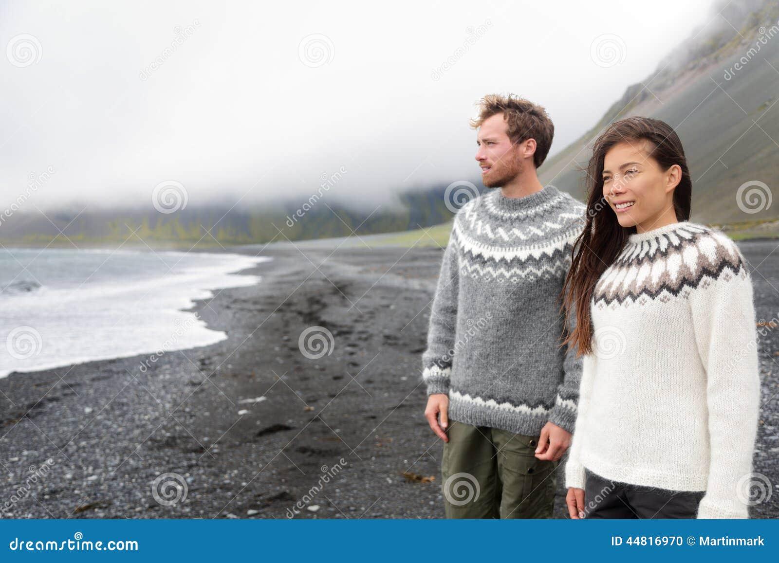 Iceland couple wearing Icelandic sweaters on beach