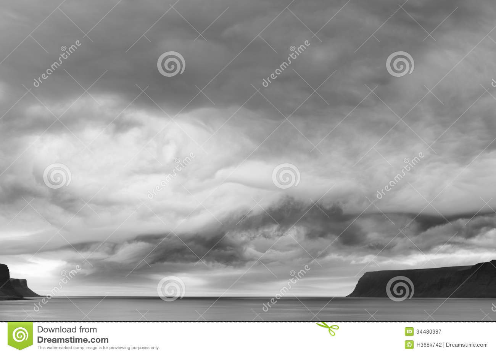 Patreksfjordur Iceland  city photo : Dramatic cloudy sky at Iceland sea coast Patreksfjordur fiord black ...